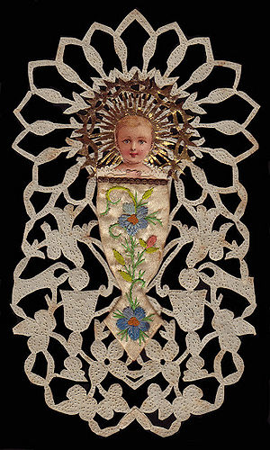 Bambino with birds hand cut and ornamented 1800s France copy.jpg